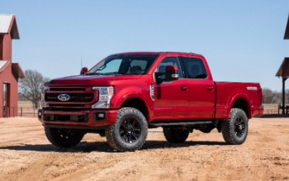 """<a href=""""https://novlanbros.com/inventory/?asc=1&orderBy=price&newUsed=New&make=Ford""""><img src=""""images/upload/September-2021/2022-ford-super-duty-lariat.png""""alt=""""A red 2021 Ford F-250 Lariat parked on a dirt road, with a farm setting in the background""""/></a>"""