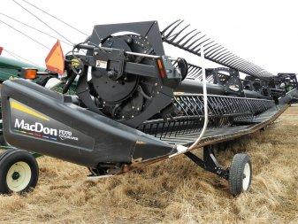 2010 MACDON FD70 JD ADAPTER - Image 1