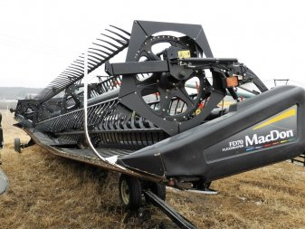 2010 MACDON FD70 JD ADAPTER - Image 0